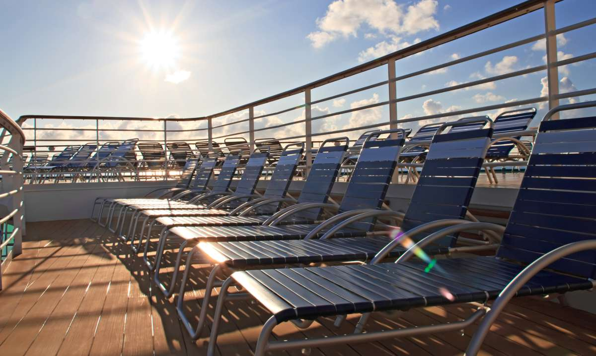 https://tampacruiseport.com/wp-content/uploads/2016/01/Chaise-longues-on-deck-of-cruise-ship-red.jpg